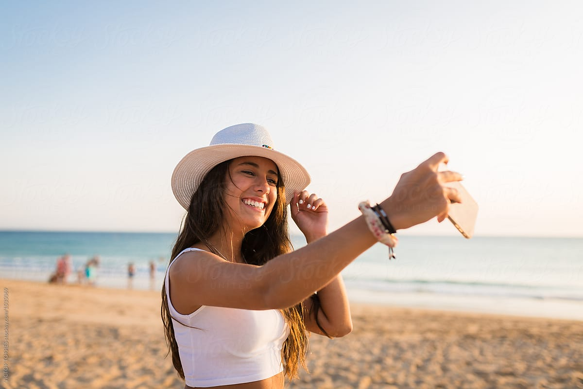 Woman taking a selfie of her smile on the beach