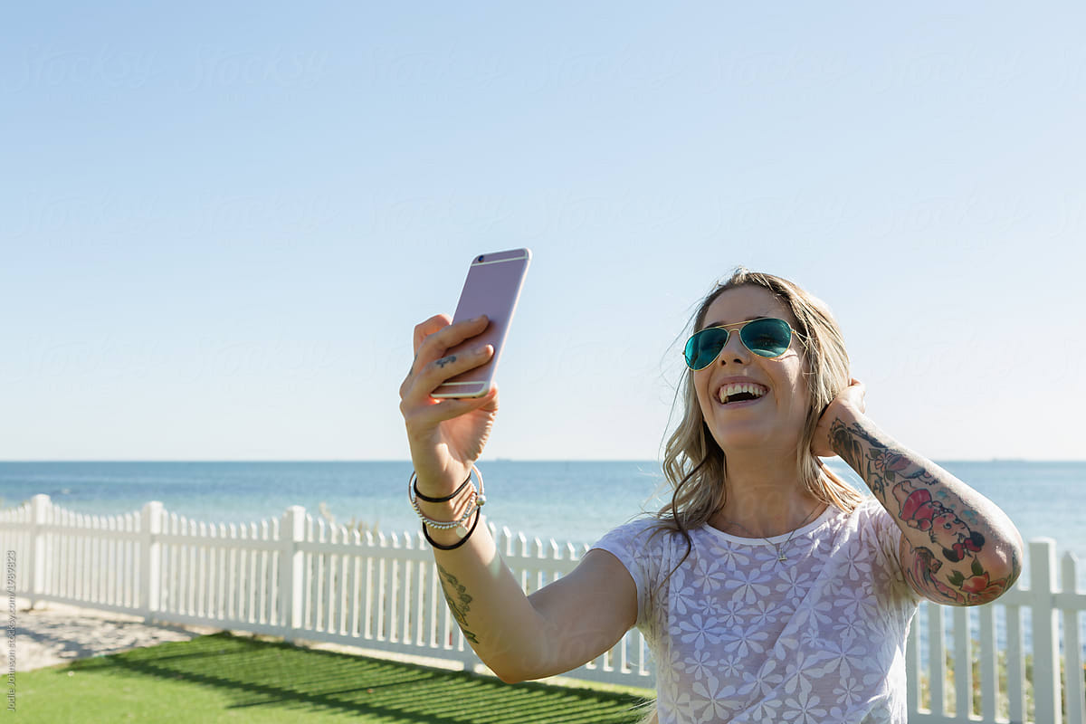 Woman taking a selfie of her smile at the beach
