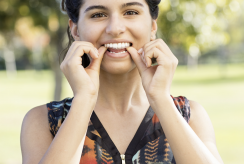 Teenager putting on Invisalign Aligners
